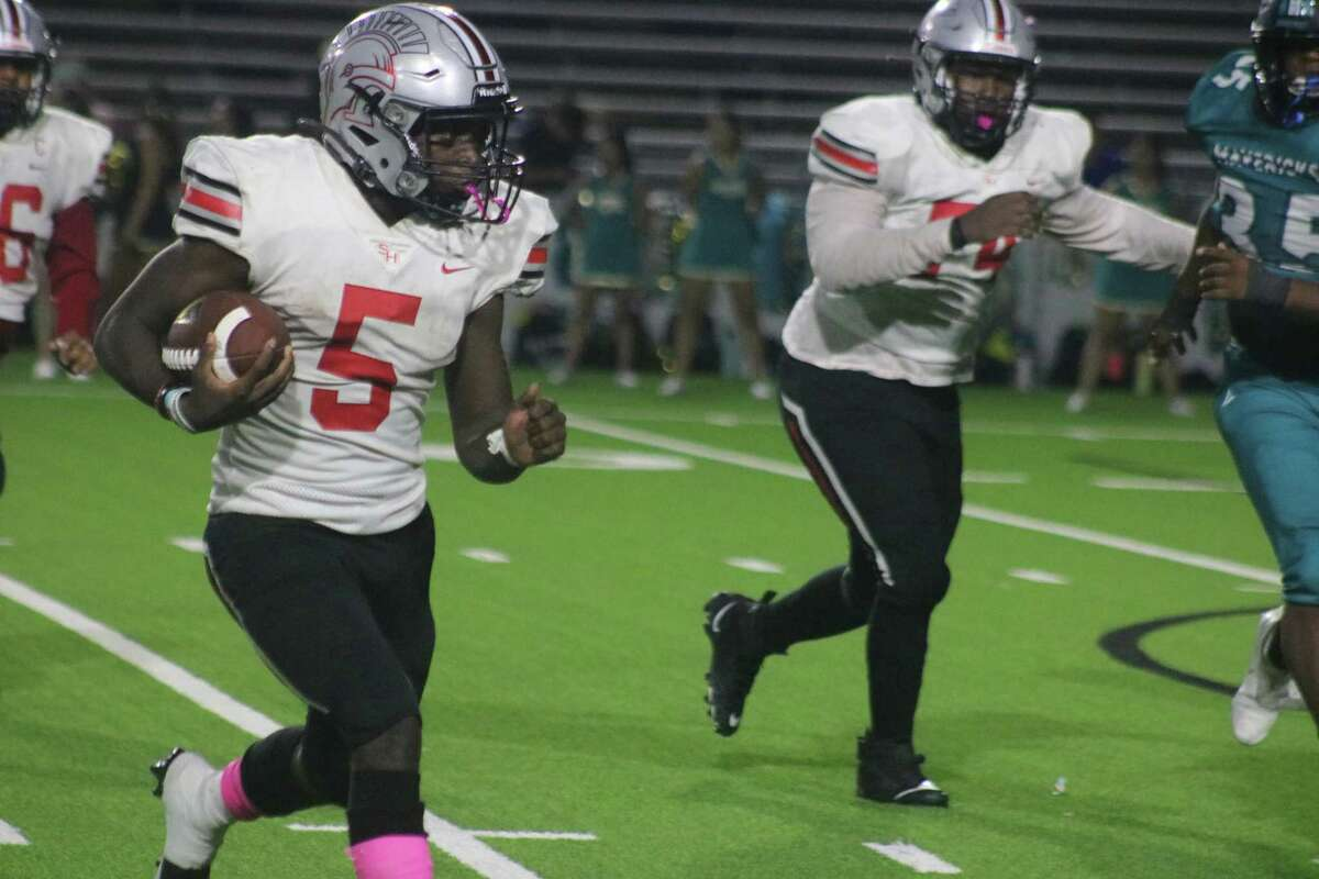 South Houston's Christian Epps pursues more yardage during second-half action Friday night. Epps rushed for 111 yards and two touchdowns.