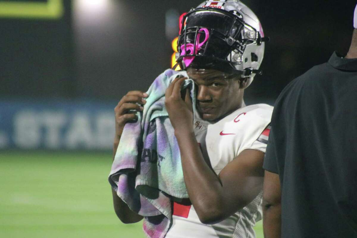 Trojans quarterback Kam'ron Webb had a good night, but it would have been better were it not for the two interceptions he threw in the end zone.