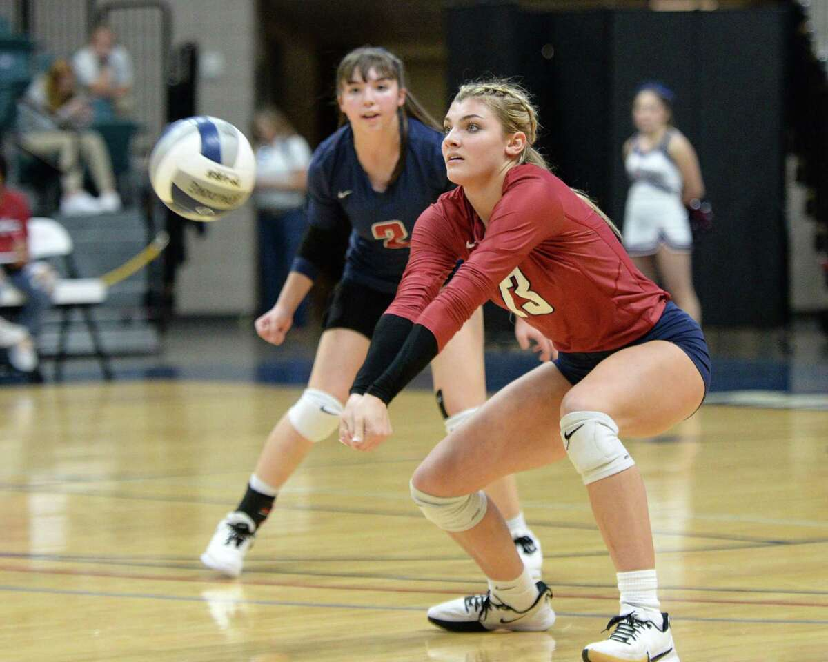 Paris Herrman (13) of Tompkins digs for a ball during the first set of a Class 6A Region III bi-district volleyball playoff match between the Tompkins Falcons and the Ridge Point Panthers on Tuesday, November 5, 2019 at the Leonard Merrell Center, Katy, TX.