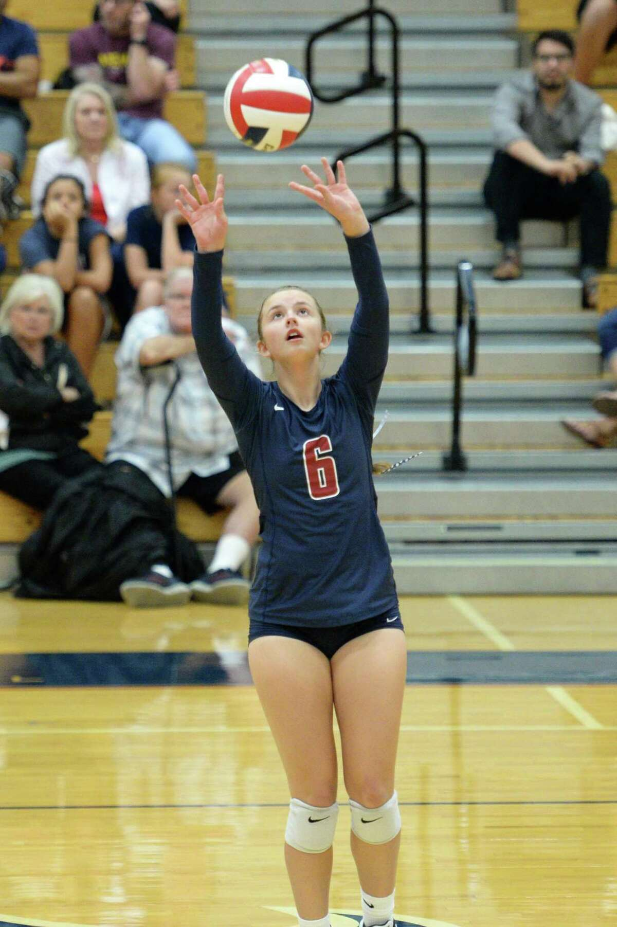 Cassidy Karonka (6) of Tompkins sets a ball during the third set of a volleyball match between the Tompkins Falcons and the Travis Tigers on Tuesday, August 6, 2019 at the Travis HS, Katy, TX.