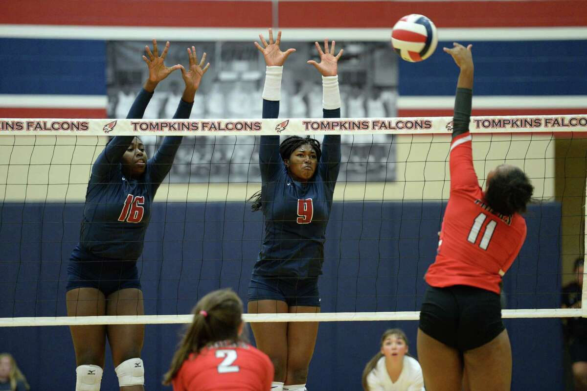 Natassia Baptiste (16) and Tendai Titley (9) of Tompkins try to block a shot during the second set of a volleyball match between the Tompkins Falcons and the Travis Tigers on Tuesday, August 6, 2019 at the Travis HS, Katy, TX.