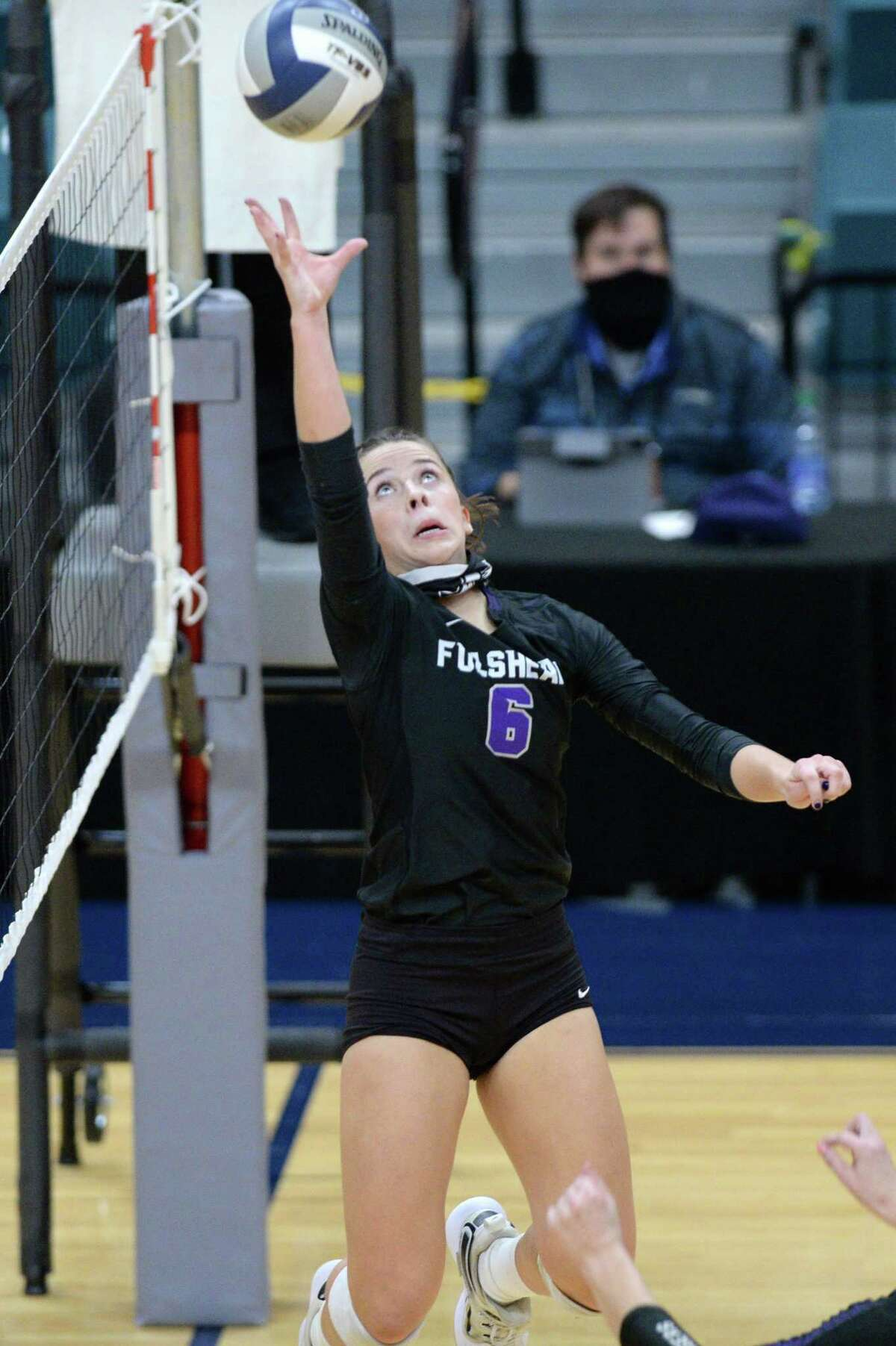 Ava Underwood (6) of Fulshear tips a ball during the second set of the Class 5A state semifinal volleyball match between the Fulshear Chargers and the Dripping Springs Tigers on Tuesday, December 8, 2020 at Leonard Merrell Center, Katy, TX.