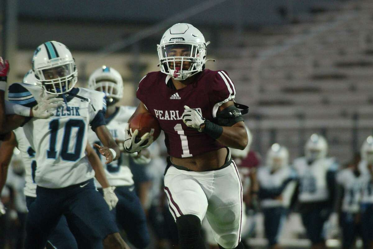 Pearland's Izeal Jones (1) pulls down a long pass and and sprints down the field for a touchdown against Alief Elsik Friday at The Rig.
