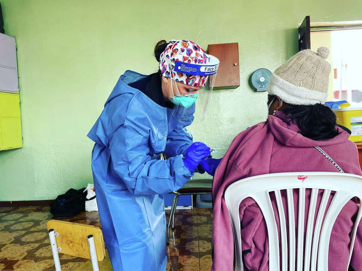 Emily Fawcett, a Darien native, vaccinates a patient in Quito, Ecuador during a vaccination mission in July, 2021.