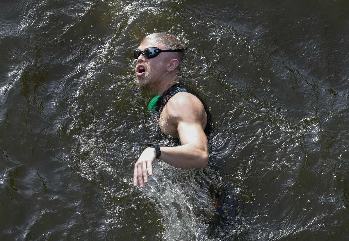 A triathlete compete in the swimming portion of the Ironman Triathlon, Saturday, Oct. 9, 2021, in The Woodlands.