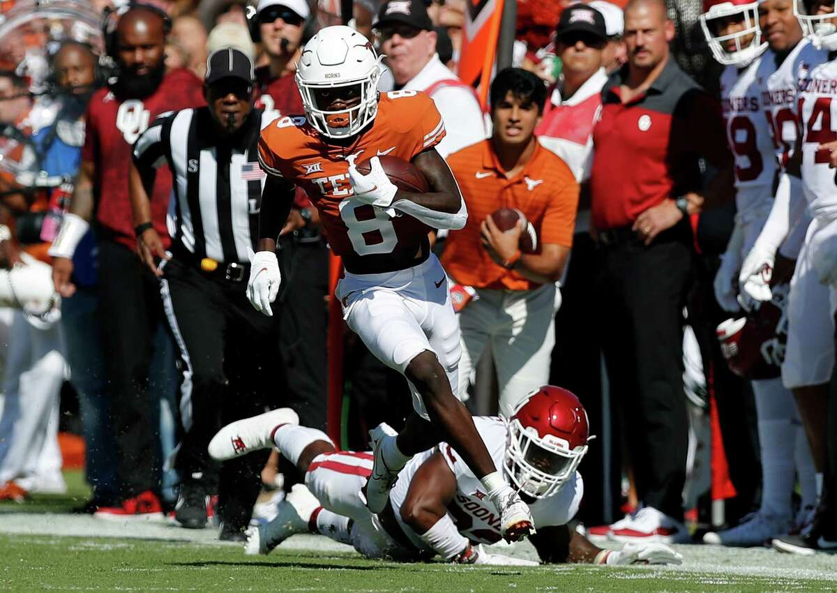 DALLAS, TEXAS - OCTOBER 09: Xavier Worthy #8 of the Texas Longhorns catches a pass for a touchdown in the first quarter against the Oklahoma Sooners during the 2021 AT&T Red River Showdown at Cotton Bowl on October 09, 2021 in Dallas, Texas.