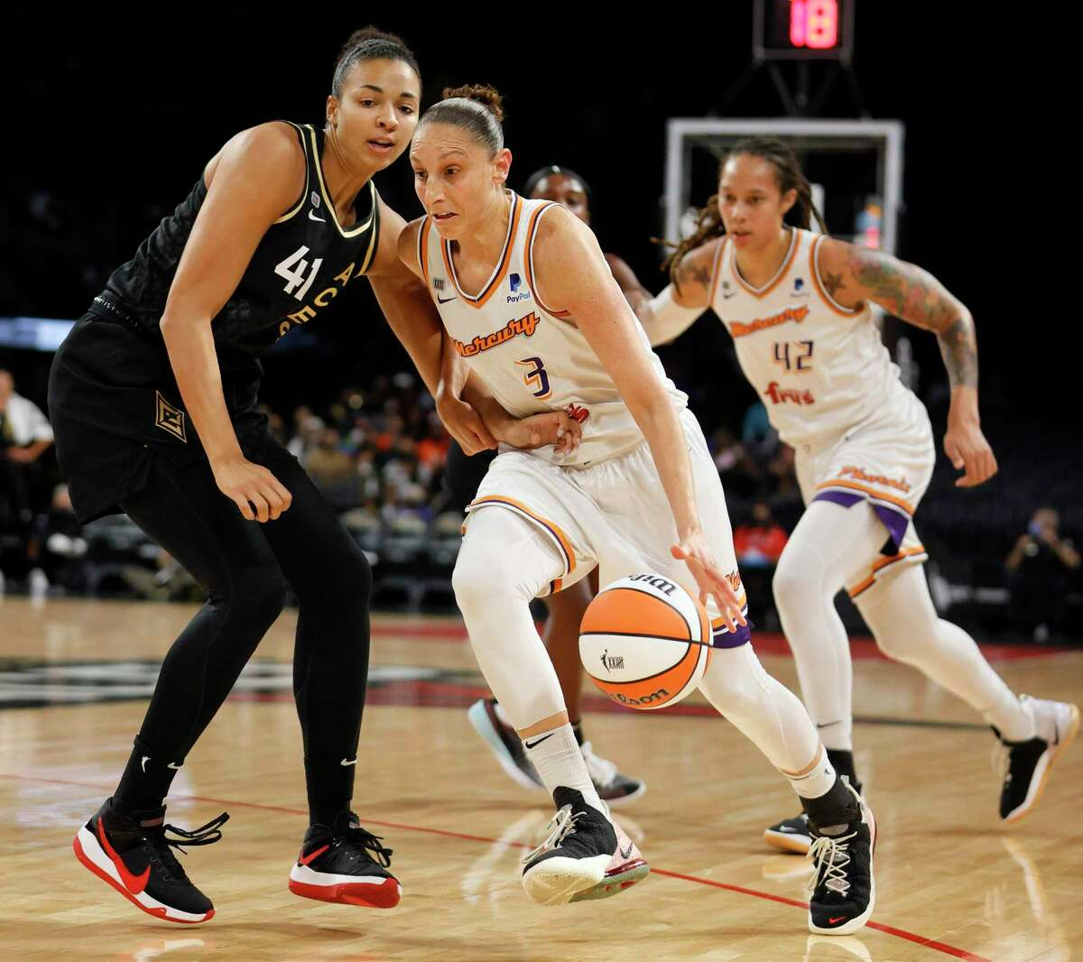 The Mercury's Diana Taurasi drives against the Aces' Kiah Stokes during Game 5 of the WNBA semifinals on Friday.