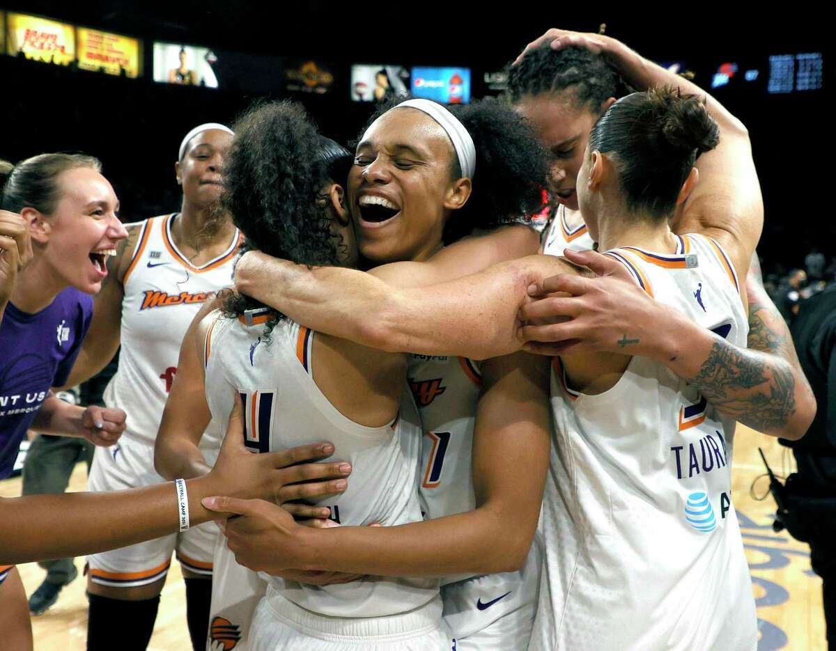 The Phoenix Mercury, including Skylar Diggins-Smith (4), Brianna Turner (21), Brittney Griner (42) and Diana Taurasi (3) celebrate after defeating the Las Vegas Aces in Game 5 of the WNBA semifinals on Friday.