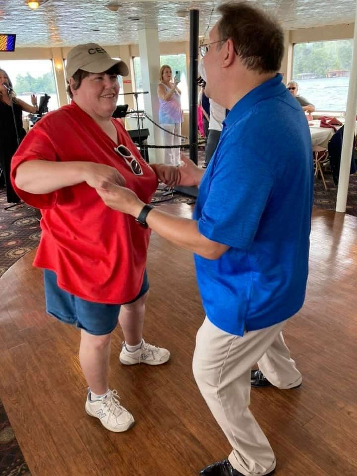 Our House member Kathleen Schleich dances with a dance studio student during a group cruise on Lake George. The social group for disabled adults in Clifton Park has changed members' lives.