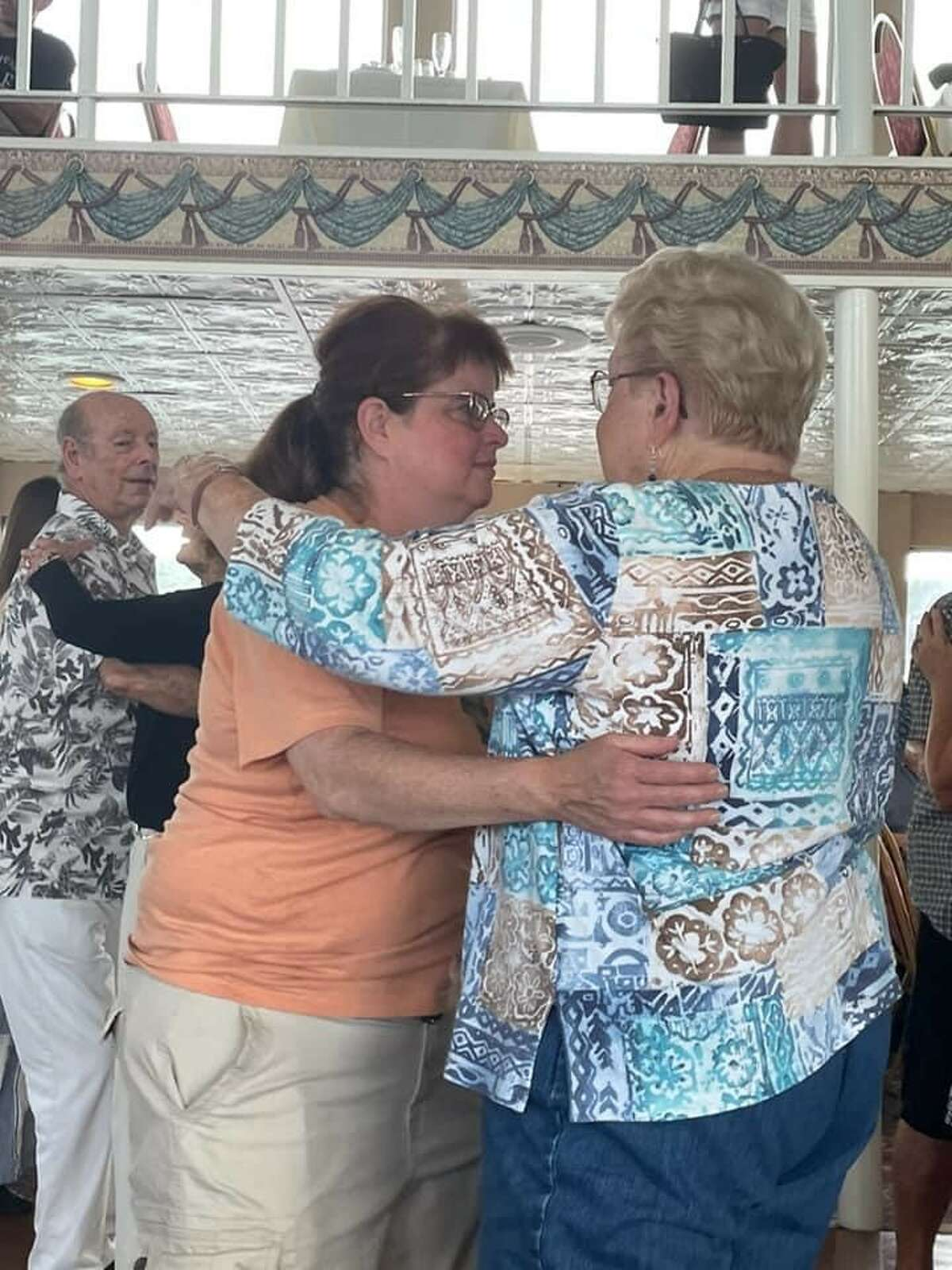 Our House member Gana McDermott dances with her mother, Georgianna McDermott, during the group's cruise on Lake George.