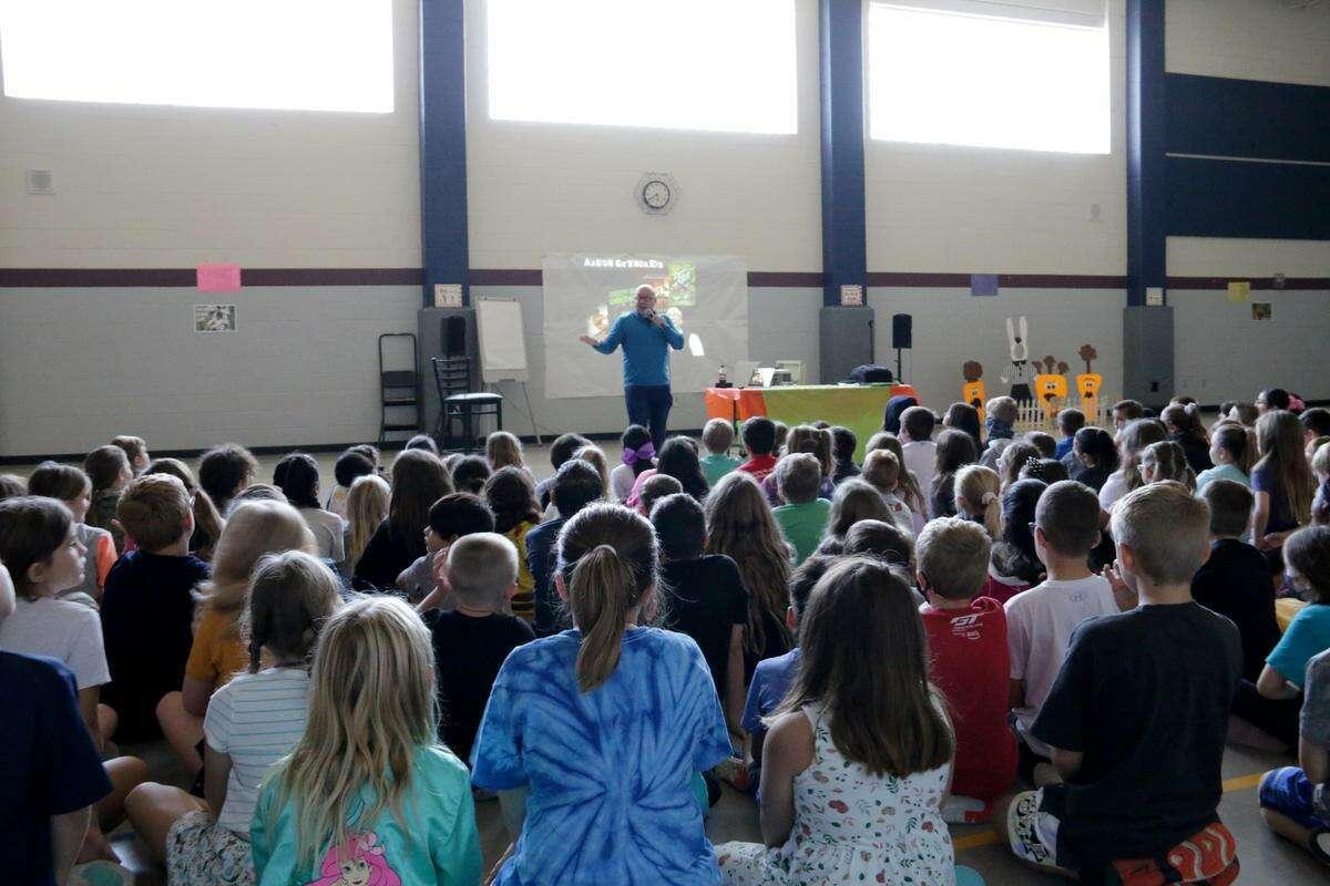 Children's book author Aaron Reynolds talks with Magnolia ISD elementary students.