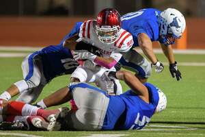 The Cigarroa High School defense take down a Rio Grande City Rattlers runner, Friday, Oct. 8, 2021, at Shirley Field.