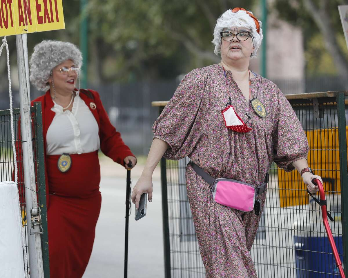 Granny Gang member Sarah Hughes walks past Elizabeth Strauss during the annual Conroe Cajun Catfish Festival on Saturday October 9, 2021 in Conroe.