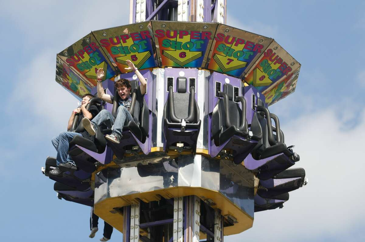 Jonathan Harcrow screams as he enjoys a carnival ride at the annual Conroe Cajun Catfish Festival, Saturday, October 9, 2021, in Conroe.