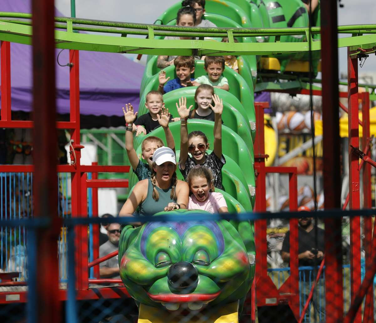 Sarah May, left, scream as she rides the Wacky Worm with her daughter, Eva, during the annual Conroe Cajun Catfish Festival, Saturday, Oct. 9, 2021, in Conroe.
