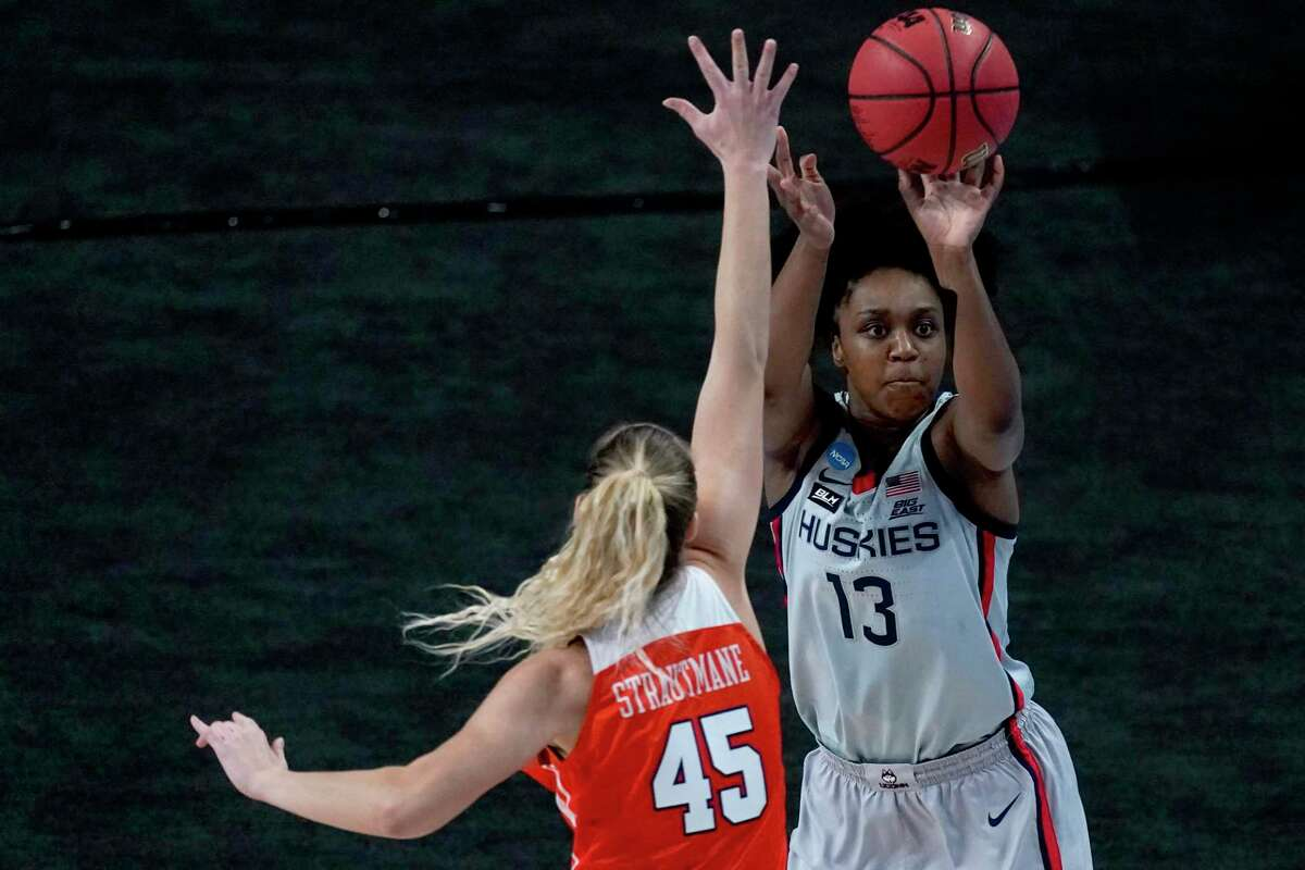 UConn guard Christyn Williams (13) shoots over Syracuse forward Digna Strautmane during the first half of a second-round game of the NCAA tournament in March.