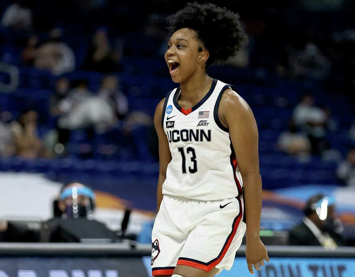 UConn's Christyn Williams celebrates her three-point shot in the first half against Iowa during the Sweet Sixteen round of the NCAA Tournament in March.