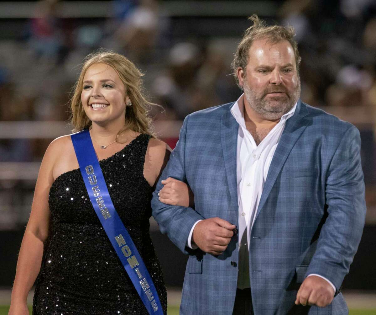 Midland Christian homecoming court nominee Tatum Fleming escorted by her father, Cody, 10/08/2021 at Gorgon Awtry Field. Tim Fischer/Reporter-Telegram