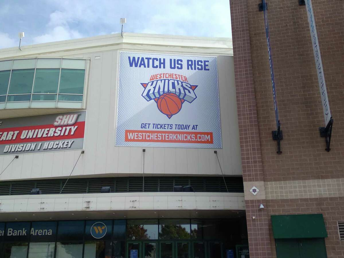 A banner outside Webster Bank Arena advertises the minor league Westchester Knicks on Saturday.