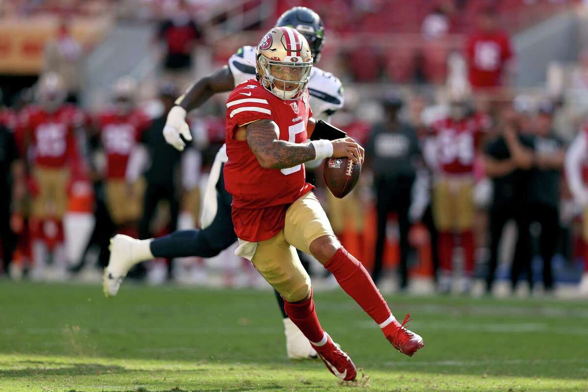 Trey Lance (5) of the San Francisco 49ers runs the ball during the fourth quarter against the Seattle Seahawks at Levi's Stadium on Sunday, Oct. 3, 2021 in Santa Clara, California. (Ezra Shaw/Getty Images/TNS)