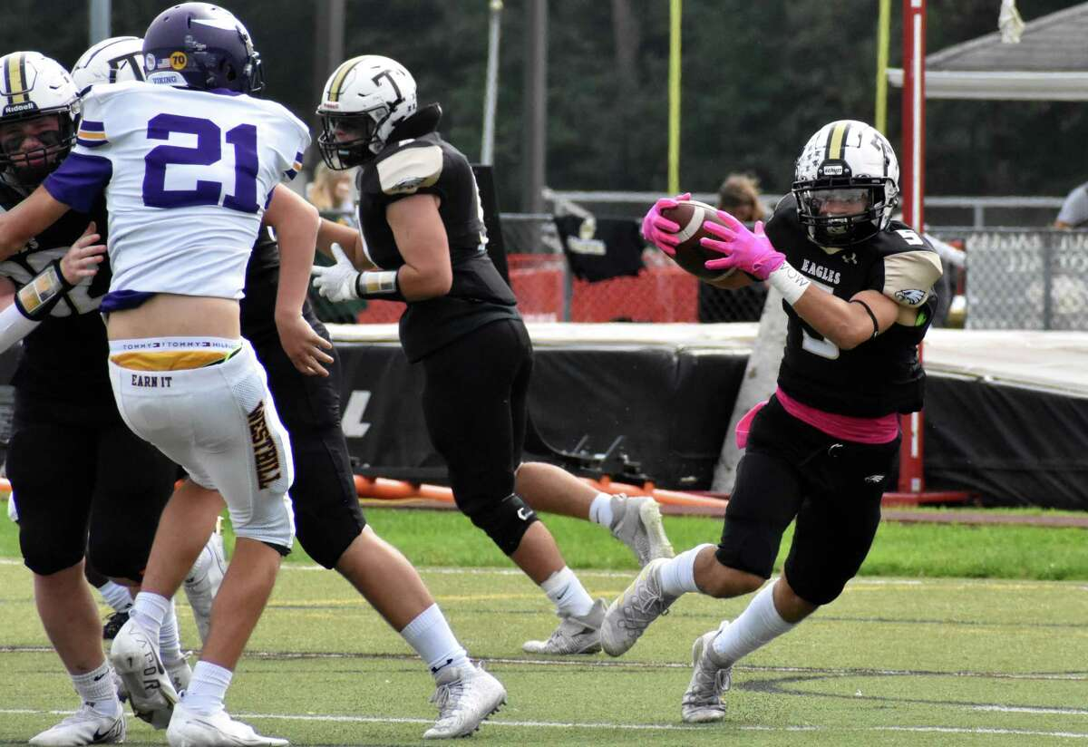 Trumbull's Corbin Smith looks for a hole to run through during Saturday's game against Westhill.