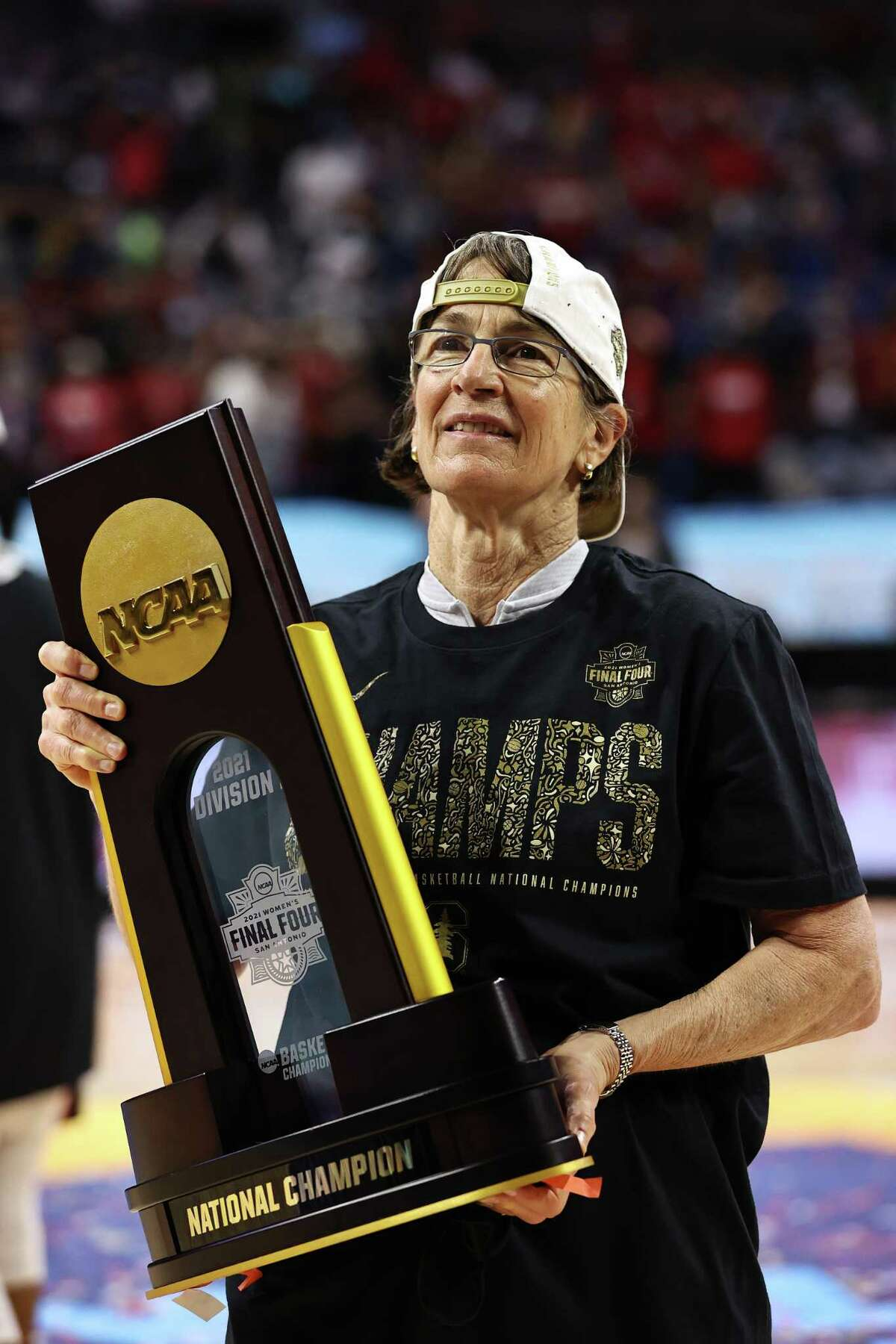 Stanford coach Tara VanDerveer celebrates with the trophy after the team's win against Arizona in the National Championship game on April 4, 2021. VanDerveer said things have changed a lot from when she was playing in college, starting at UAlbany.