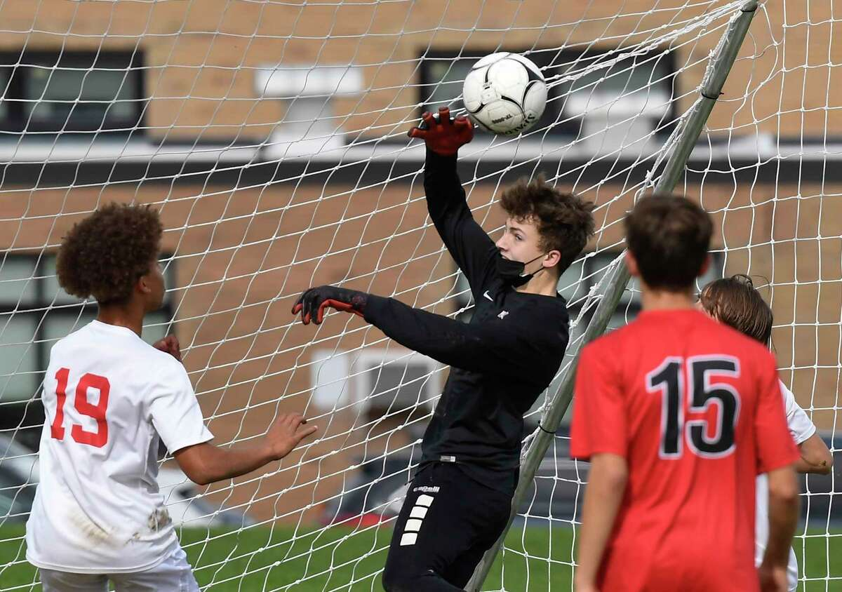 Mechanicville goalkeeper Dylan Raucci defends against Guilderland during the first half of a high school soccer game Saturday, Oct. 9, 2021, in Guilderland, N.Y. (Hans Pennink/Special to the Times Union) ORG XMIT: 101021_bsoccer_HP105