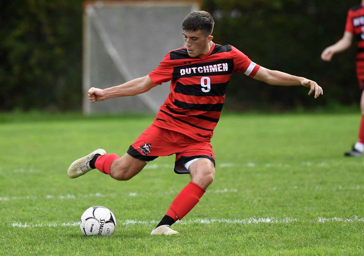 Guilderland's Quinn Tynan moves the ball against Mechanicville during the first half of a high school soccer game Saturday, Oct. 9, 2021, in Guilderland, N.Y. (Hans Pennink/Special to the Times Union) ORG XMIT: 101021_bsoccer_HP113