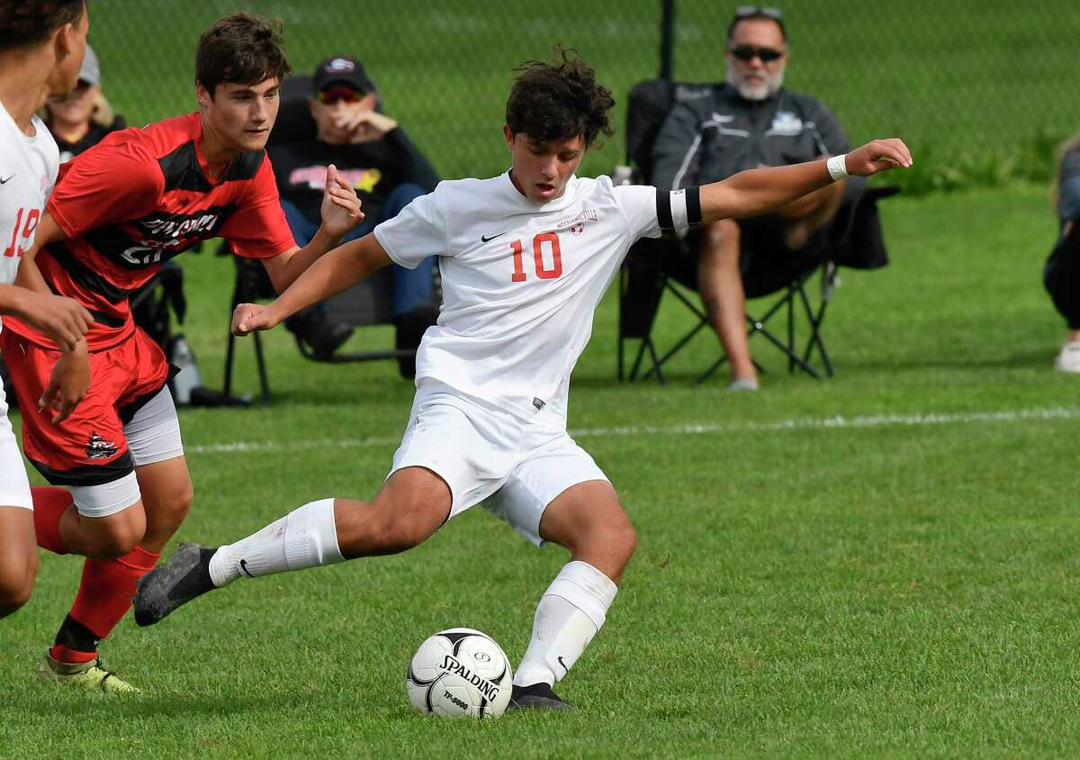 Mechanicville's Andrew Kraszweski (10) moves the ball against Guilderland during the first half of a high school soccer game Saturday, Oct. 9, 2021, in Guilderland, N.Y. (Hans Pennink/Special to the Times Union) ORG XMIT: 101021_bsoccer_HP116