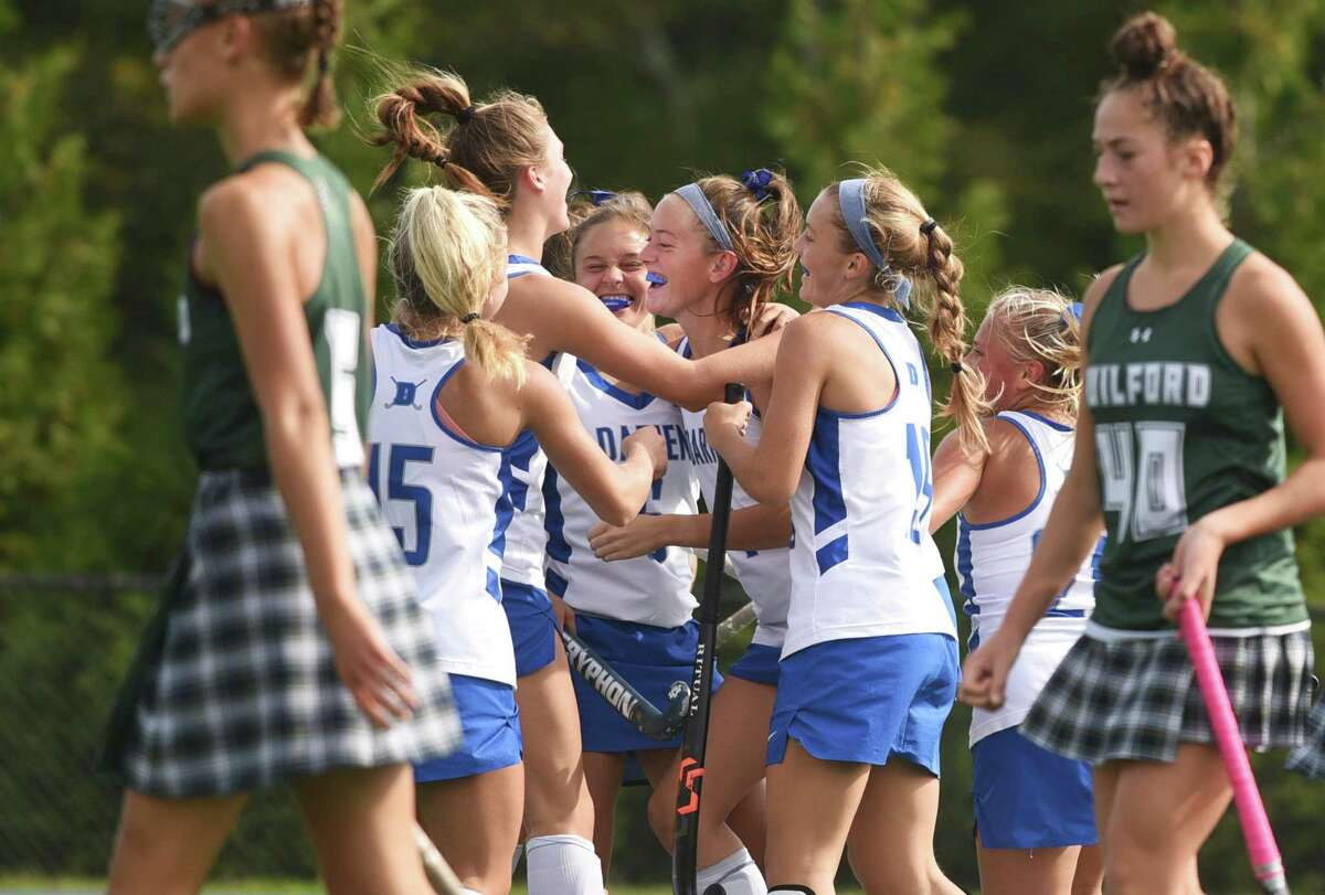 Darien field hockey players celebrate a third-quarter goal during their game against Guilford on Saturday.