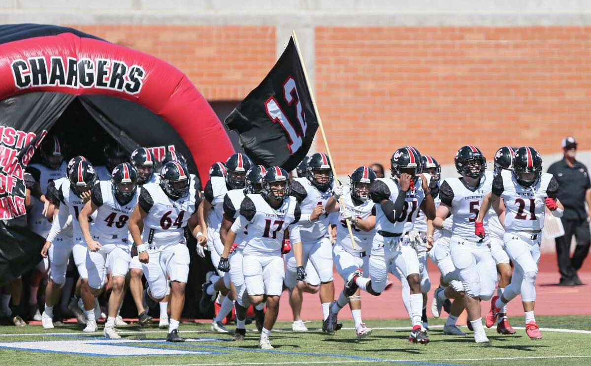 Members of the Churchill football team take to the field prior tp the UIL football game against Reagan Saturday, Oct. 9, 2021, at Heroes Stadium in San Antonio, Texas. [Sam Grenadier/San Antonio Express-News]