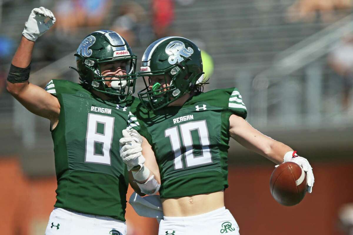 Reagan wide receiver Luke Sasser (10) and defensive back Bryce Hamilton (8) celebrate a douchdown during the UIL football game against Churchill Saturday, Oct. 9, 2021, at Heroes Stadium in San Antonio, Texas. [Sam Grenadier/San Antonio Express-News]