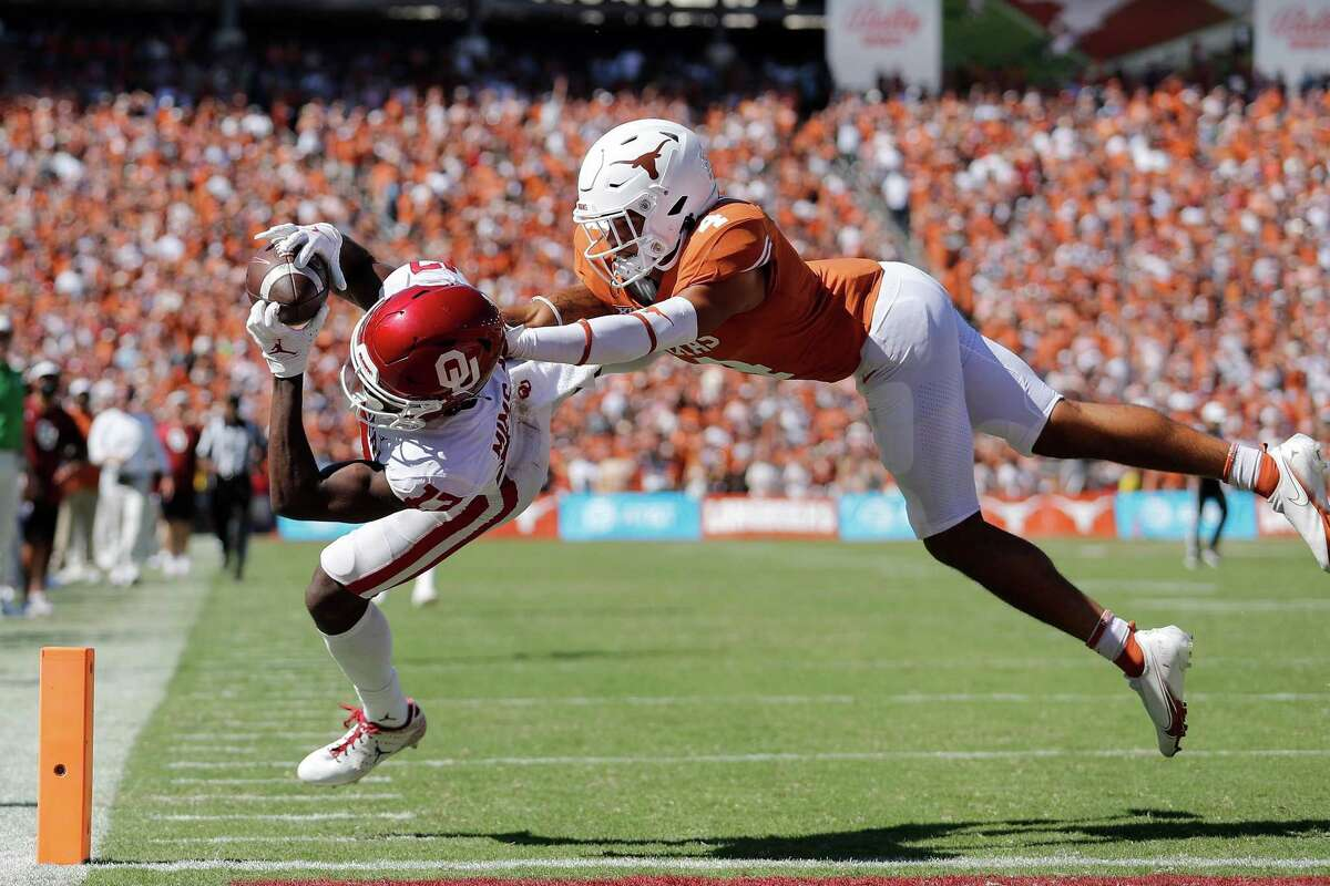 Oklahoma's Marvin Mims beats Texas' Darion Dunn for a 52-yard TD catch that tied the game in the fourth quarter after the Sooners had trailed by 18 just nine minutes earlier. After the Horns dominated early, OU outplayed and outschemed UT throughout the second half.