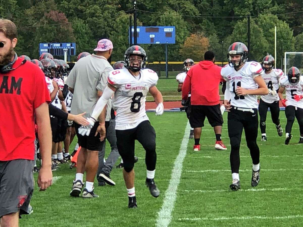 Cromwell/Portland's Teddy Williams revs up his sideline after scoring on a 62-yard punt return in the fourth quarter of Saturday's game against Valley Regional/Old Lyme.