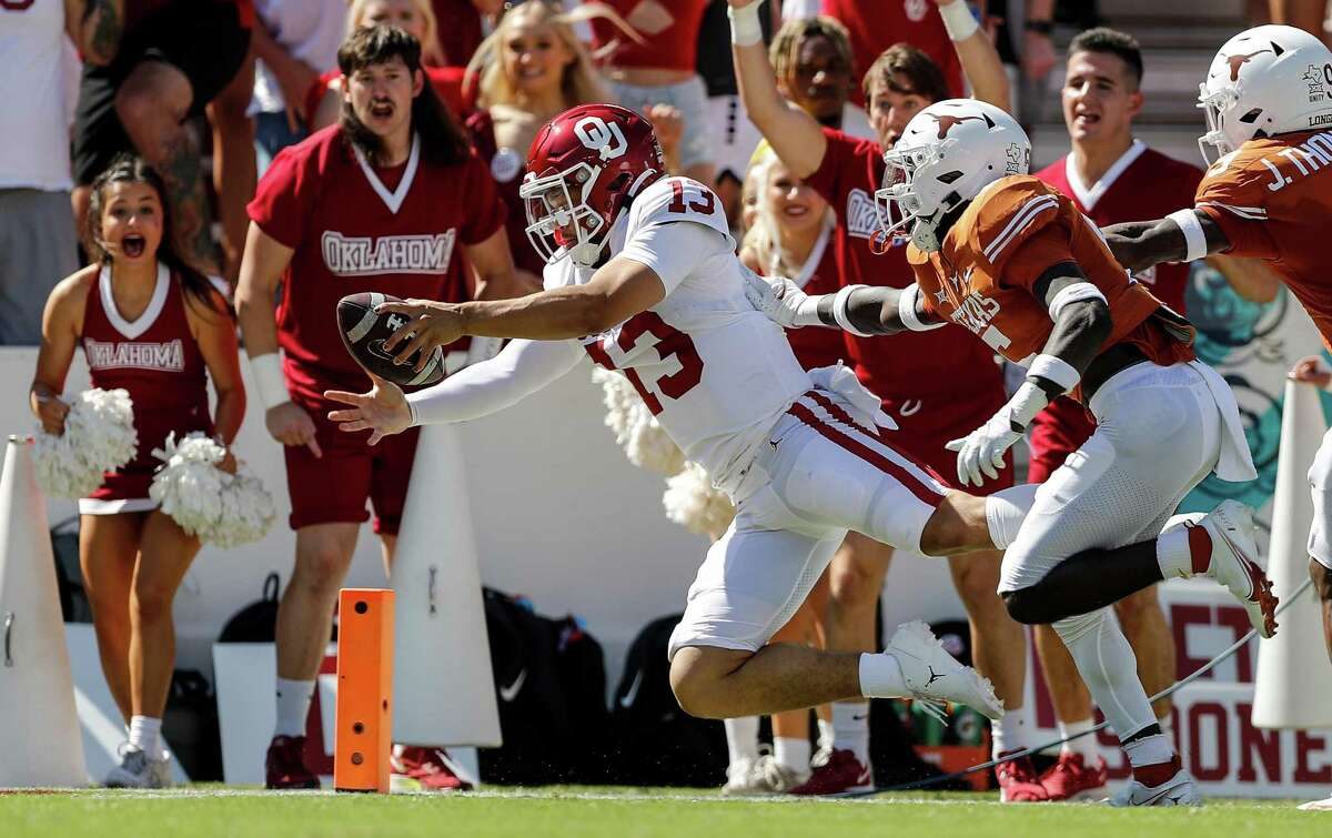 Sooners QB Caleb Williams dives for a first-half score. He came up big after replacing starter Spencer Rattler, accounting for 300 total yards and 3 TDs.