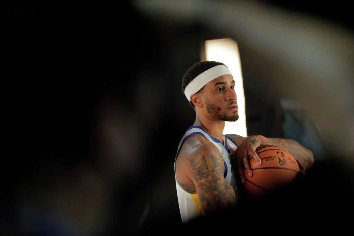 Gary Payton II has his portrait made as the Golden State Warriors held their media day for the 2021-22 season at Chase Center in San Francisco, Calif., on Monday, September 27, 2021.