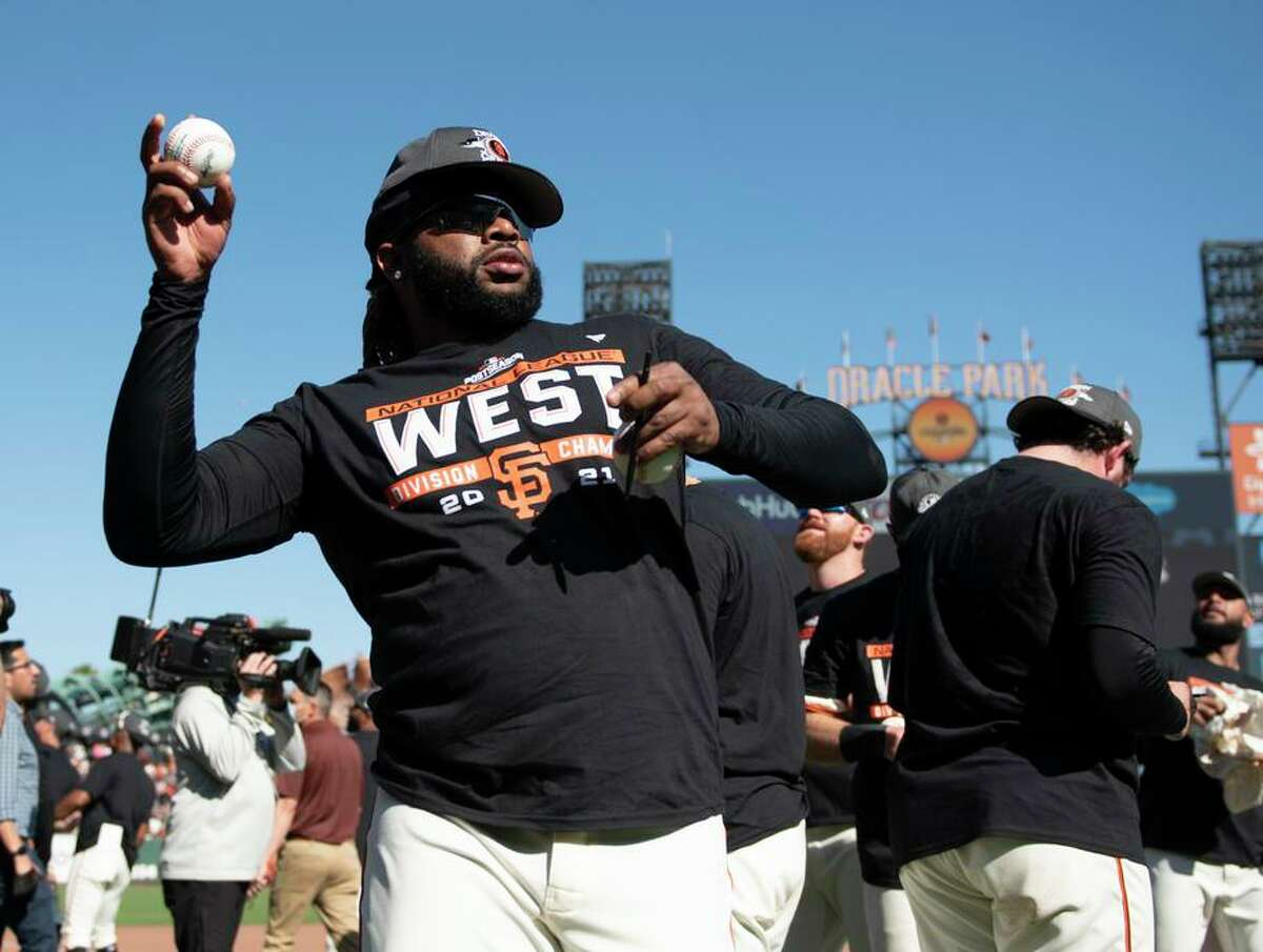 SAN FRANCISCO, CALIFORNIA - OCTOBER 03: Johnny Cueto #47 of the San Francisco Giants signs a baseball and throws to the crowd after a game against the San Diego Padres at Oracle Park on October 03, 2021 in San Francisco, California. (Photo by Brandon Vallance/Getty Images)