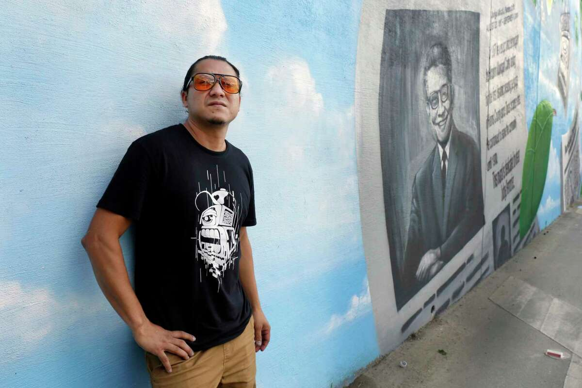 Artist Gelson Lemus stands by one of his mural panels during an unveiling ceremony of a new mural at the tunnel entrance honoring Judge Alfred J. Hernandez, the first Hispanic judge in Harris County, Saturday, Oct. 9, 2021 in Houston, TX.