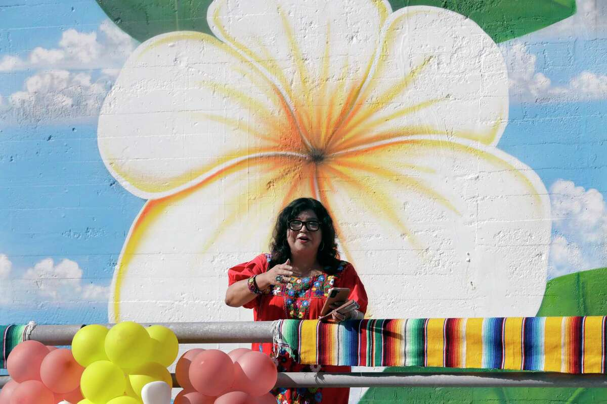 Rebecca Reyna, executive director of the Greater Northside Managment District, speaks during an unveiling ceremony of the new mural at a tunnel entrance honoring Judge Alfred J. Hernandez, the first Hispanic judge in Harris County, Saturday, Oct. 9, 2021 in Houston, TX.