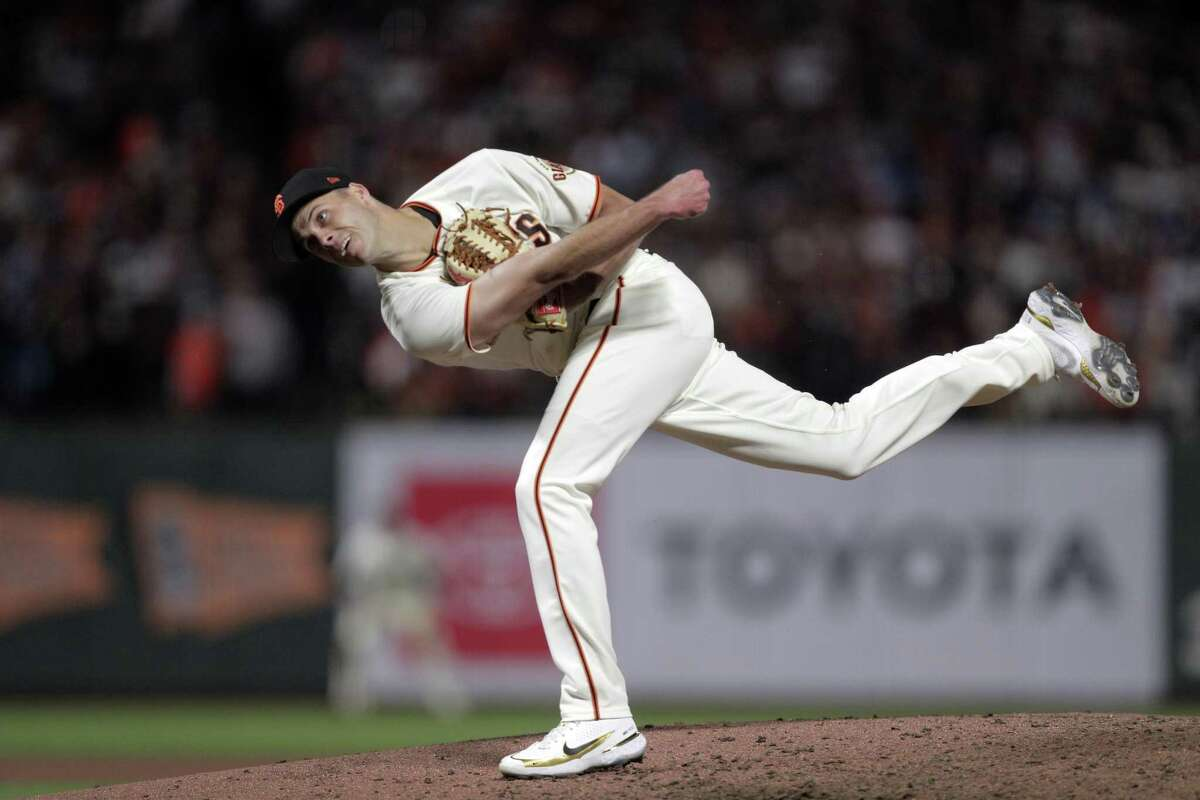 Tyler Rogers pitches in the eighth as the San Francisco Giants played the Los Angeles Dodgers in Game 1 of the National League Division Series at Oracle Park in San Francisco, Calif., on Friday, October 8, 2021.