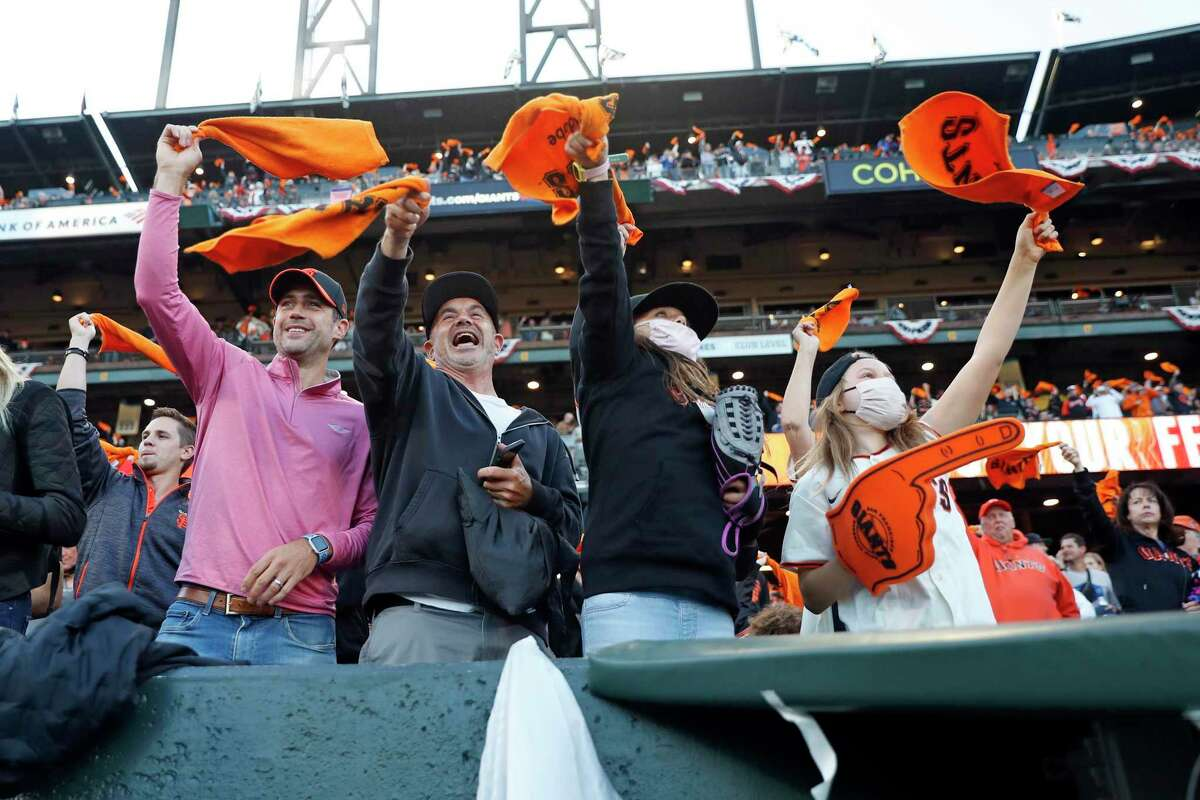 San Francisco Giants' fans wave rally towels before start of National League Division Series Game 2 at Oracle Park in San Francisco, Calif., on Saturday, October 9, 2021
