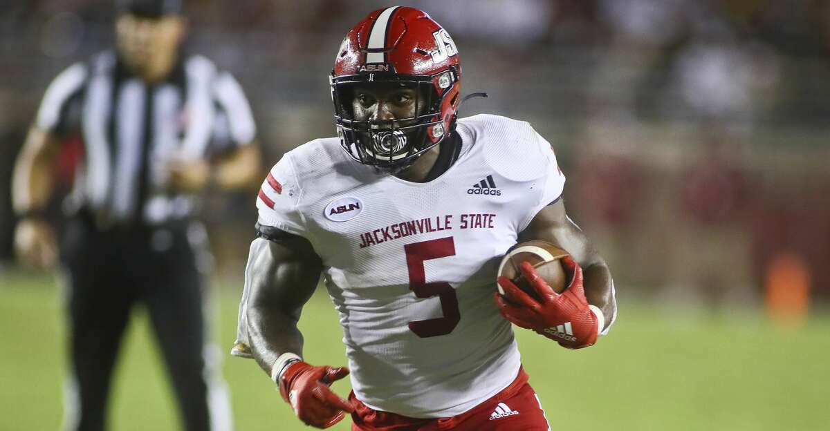 Jacksonville State running back Josh Samuel (5) runs past Florida State defensive back Kevin Knowles II (26) in the second quarter of an NCAA college football game Saturday, Sept. 11, 2021, in Tallahassee, Fla. Jacksonville State won 20-17. (AP Photo/Phil Sears)