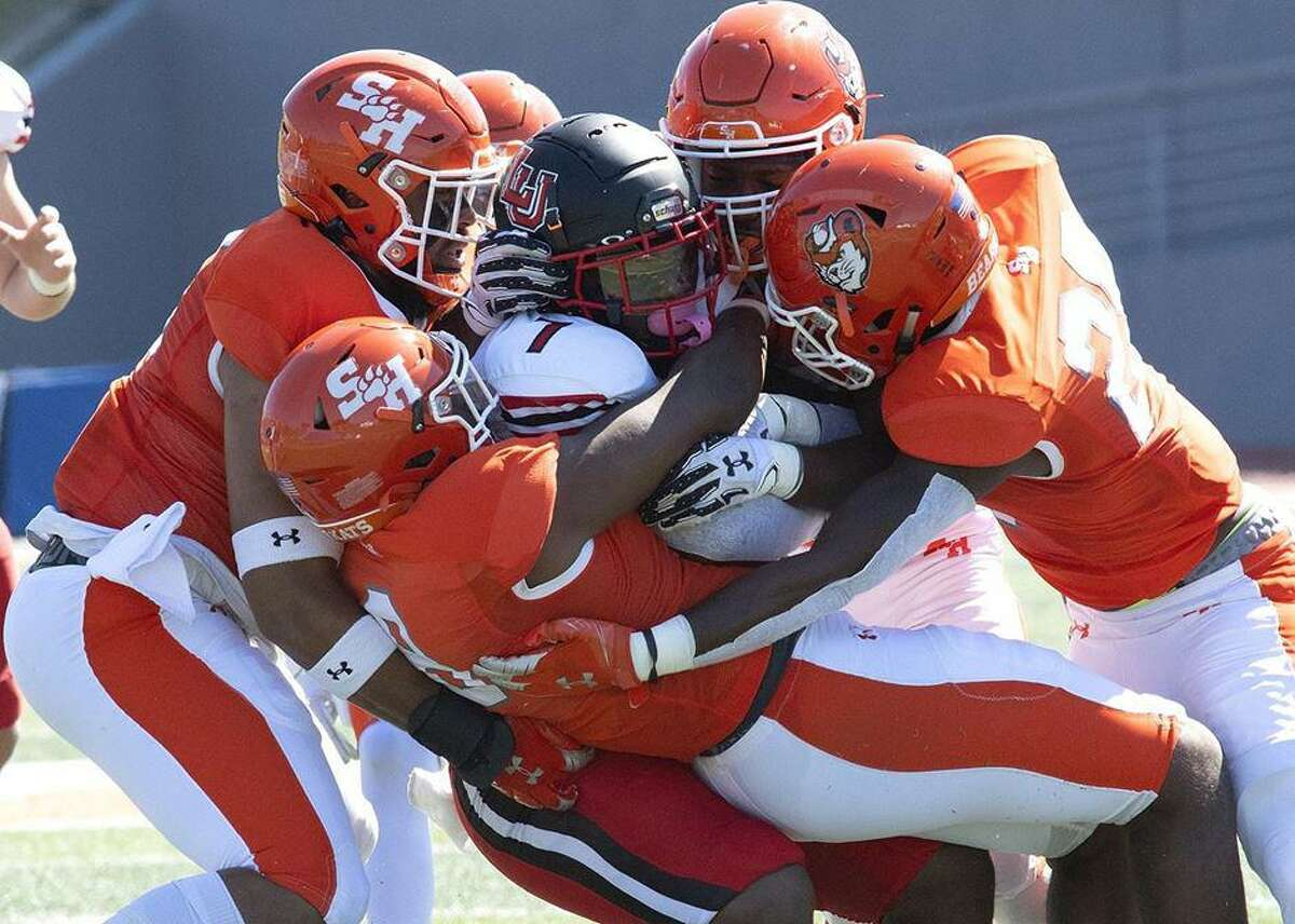 Lamar running back Chaz Ward is surrounded by Sam Houston defenders during the Cardinals' loss on Saturday in Huntsville.
