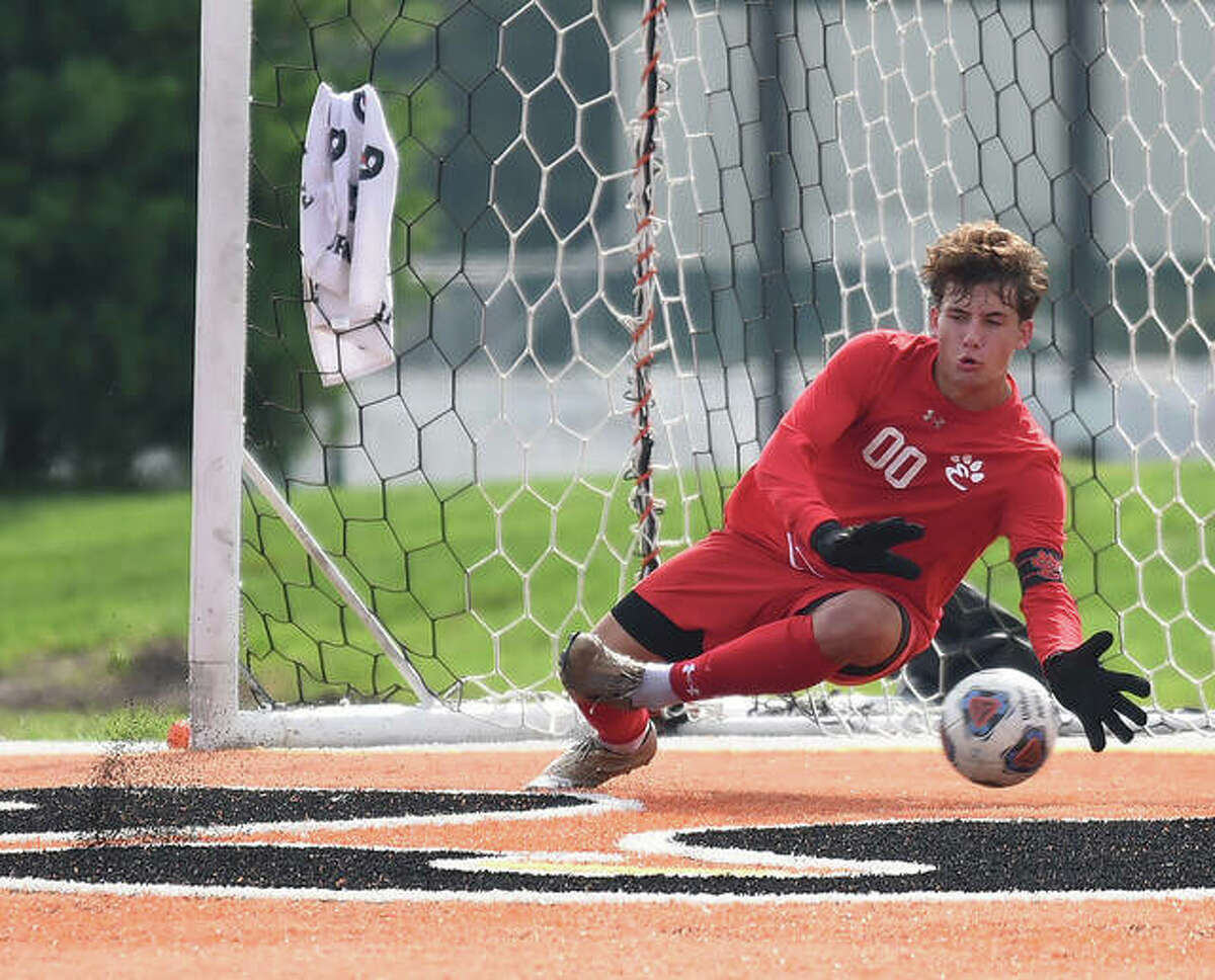 Edwardsville keeper Nathan Beck makes a diving save on a CBC shot in the first half of Saturday's game inside the District 7 Sports Complex. Web Gallery