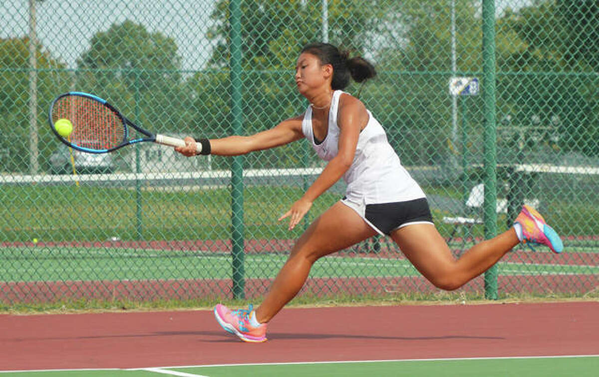 Edwardsville's Chloe Koons runs down a shot during her No. 1 singles final on Saturday in the Southwest Conference Tournament at O'Fallon.