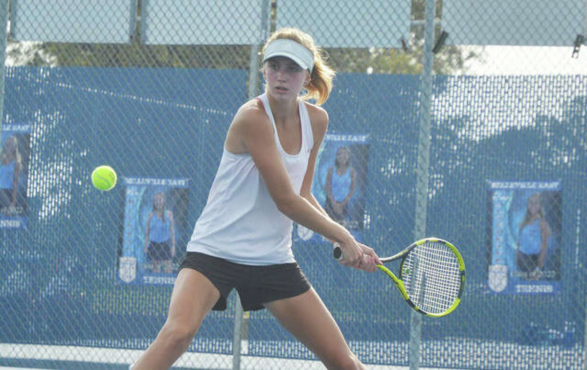 Edwardsville's Alyssa Wise makes a forehand return during her semifinal match at No. 4 singles on Saturday in the Southwest Conference Tournament at Belleville East.