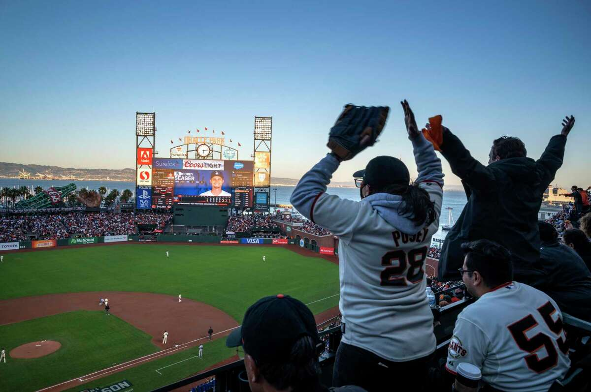 Fans react in disbelief in the first inning as the the Giants give up a stolen base to the Dodgers. The San Francisco Giants vs the Los Angeles Dodgers at Oracle Park for the National League Division Series in San Francisco, California on October 9, 2021.