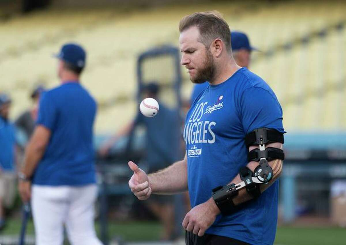 Dodgers first baseman Max Muncy is sitting out the NLDS due to an elbow injury he suffered in the last game of the regular season.