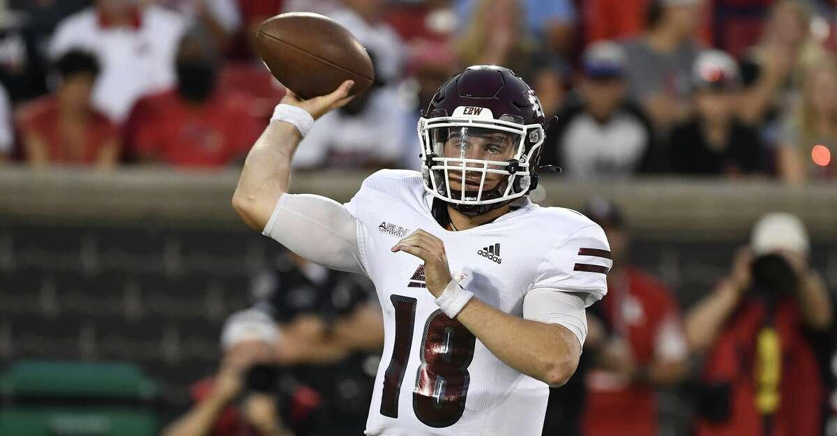 Eastern Kentucky quarterback Parker McKinney (18) attempts a pass during the first half of an NCAA college football game in Louisville, Ky., Saturday, Sept. 11, 2021. (AP Photo/Timothy D. Easley)