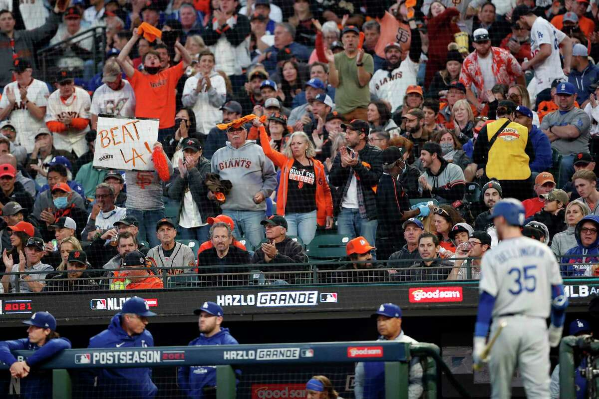 San Francisco Giants' fans cheer after Los Angeles Dodgers' Cody Bellinger struck out in 2nd inning during National League Division Series Game 2 at Oracle Park in San Francisco, Calif., on Saturday, October 9, 2021
